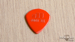 red Dunlop Jazz III guitar pick
